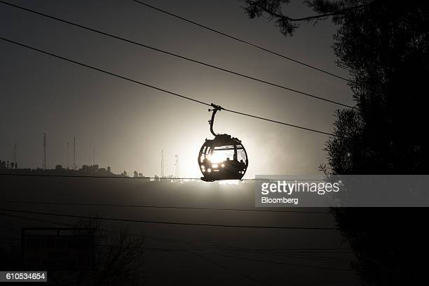 Travelers ride on the green line Mi Teleferico cable car above the city of La Paz Bolivia on Wednesday Sept 14 2016 Boliva's Mi Teleferico cable cars...