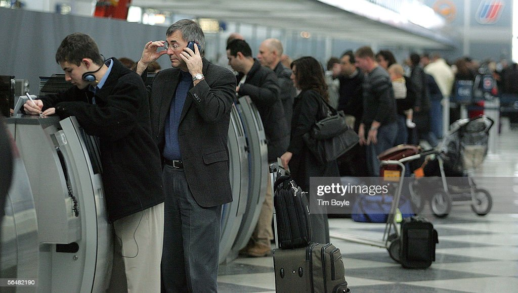 Travelers stand at United Airlines' ticket counters at O'Hare International Airport December 22, 2005 in Chicago, Illinois. According to the Transportation Security Administration (TSA), security measures will be stepped up during the busy holiday travel season when, in an estimation by AAA, 63.5 million Americans plan to travel 50 miles or more.