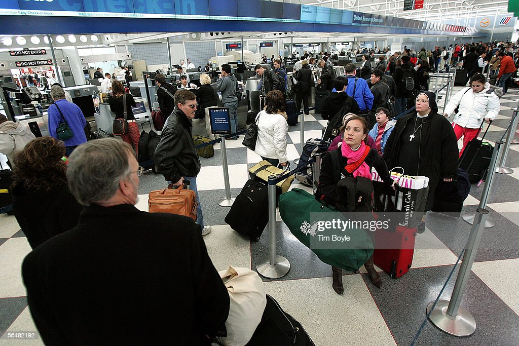 Travelers stand in line at the ticket counters of the United Airlines terminal at O'Hare International Airport December 22, 2005 in Chicago, Illinois. According to the Transportation Security Administration (TSA), security measures will be stepped up during the busy holiday travel season when, in an estimation by AAA, 63.5 million Americans plan to travel 50 miles or more.