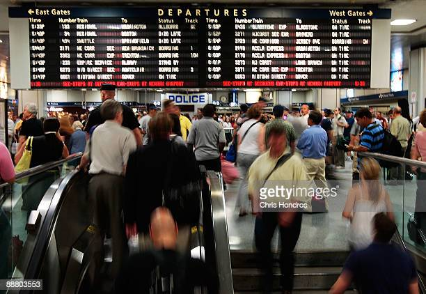 Travelers take escalators and stairs under the departures board at Manhattan's Penn Station July 2 2009 in New York City The AAA in a news release is...