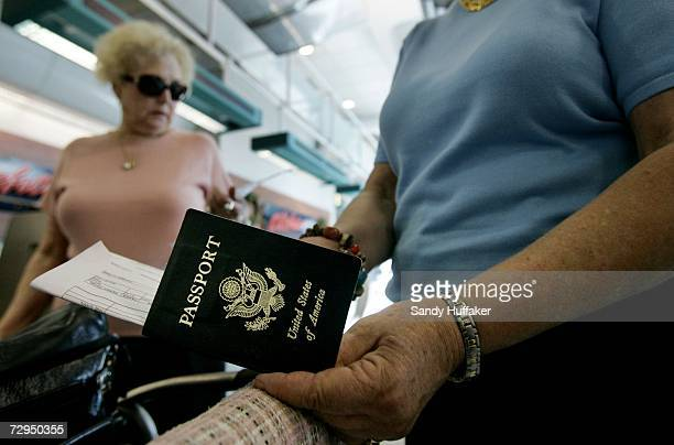 Travelers take out their passports before checking in at San Diego International Airport January 8 2006 in San Diego California Beginning on January...