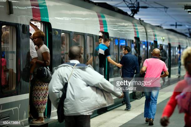 Travelers try to catch a train at the Gare du Nord railway station on June 12 2014 in Paris on the second day of a national strike by French SNCF...