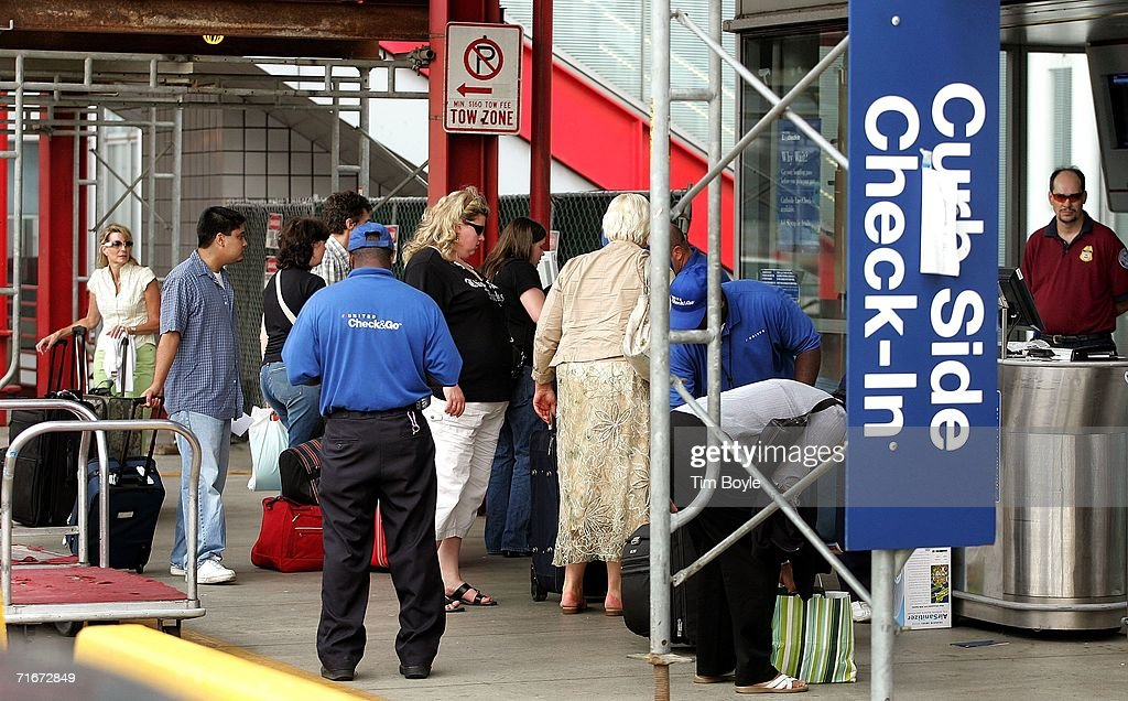 Travelers use curbside luggage checkin outside Terminal One at O'Hare International Airport August 18 2006 in Chicago Illinois Airtravel officials...