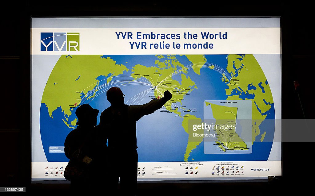 Travelers view a map at the Vancouver International Airport in Vancouver British Columbia Canada on Saturday Nov 12 2011 Vancouver a coastal seaport...