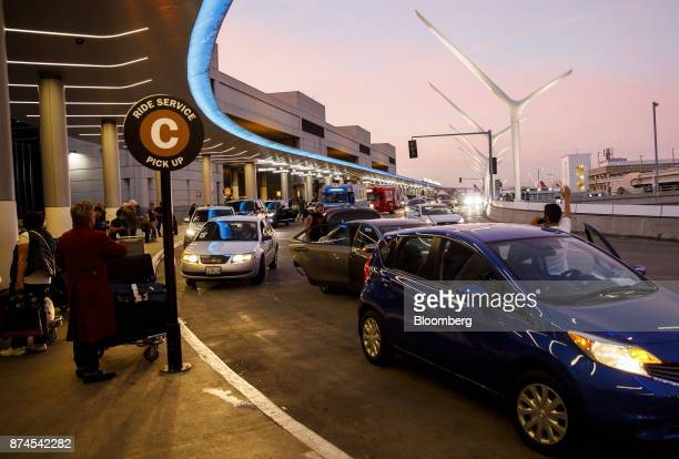 Travelers wait at a ride service pick up area at Los Angeles International Airport in Los Angeles California US on Monday Nov 13 2017 Lyft Inc has...