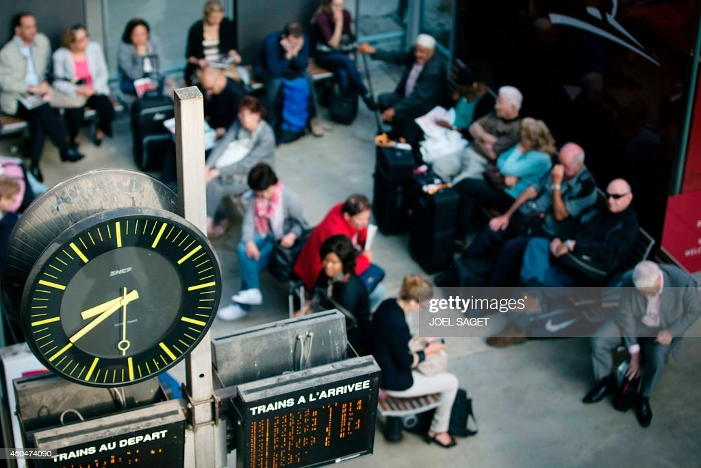 Travelers wait at the Gare du Nord railway station on June 12 2014 in Paris on the second day of a national strike by French SNCF railway company...