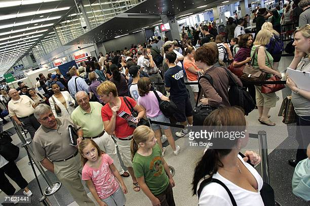 Travelers wait in line at a security checkpoint near the American Airlines ticket area in Terminal 3 at O'Hare International Airport August 10 2006...