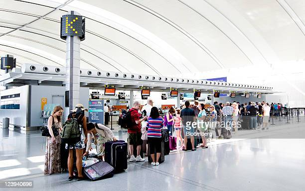 Travelers wait in line to check in at Toronto Pearson International Airport in Toronto Ontario Canada on Tuesday Aug 30 2011 Toronto Pearson...