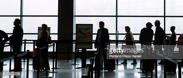 Travelers wait in line to enter the security area at the Portland International Jetport on Wednesday November 12 2014