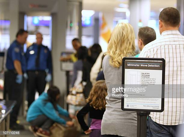 Travelers wait in line to go through the body scanner at the Salt Lake City International Airport in Salt Lake City Utah US on Wednesday Nov 24 2010...