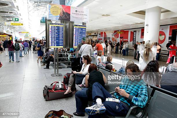 Travelers wait in the arrivals area of Lisbon International airport operated by ANAAeroportos de Portugal SA in Lisbon Portugal on Wednesday June 16...