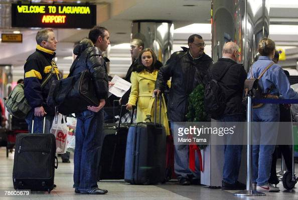 Travelers wait on line in the terminal to fly at LaGuardia Airport December 21 2007 in the Queens borough of New York City Travelers nationwide are...