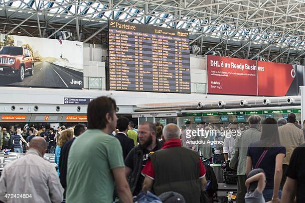 Travelers wait the Fiumicino International Airport after a fire broke out overnight on May 07 2015 Rome's main airport gradually resumed normal...
