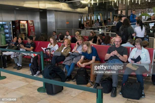Travelers wait to board a plane in Terminal 1 of Humberto Delgado Airport on April 19 2017 in Lisbon Portugal The airport is the main international...