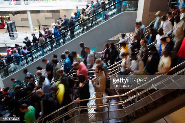Travelers walk at the Gare du Nord railway station on June 12 2014 in Paris on the second day of a national strike by French SNCF railway company...