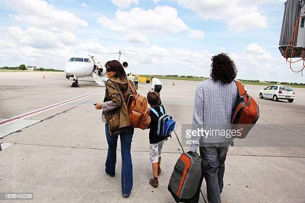 Travelers Walking Toward Airplane