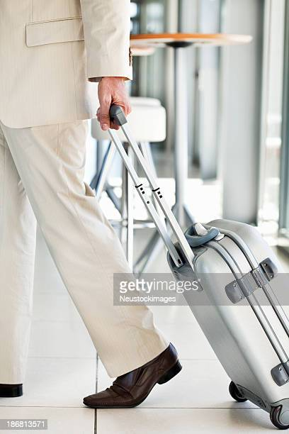 Traveling Businessman Rolling Luggage