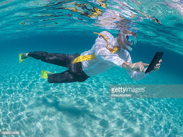 Traveling Businessman Using Digital Tablet Computer Underwater Snorkeling