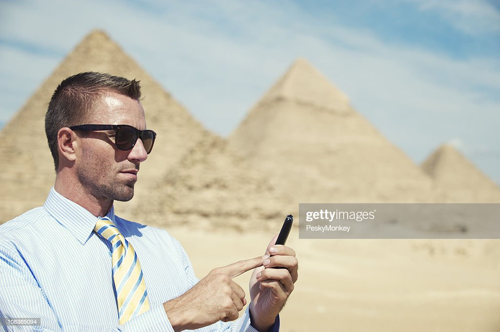 Businessman Does Some Texting at the Pyramids : Stock Photo