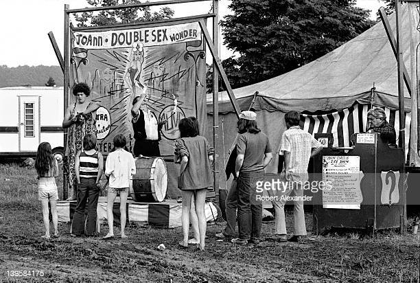 A traveling circus sideshow attracts customers to see 'JoAnn the Doublesex Wonder' during a stop in the small town of Abingdon Virginia 'JoAnn' also...
