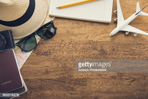 Traveling gadgets on wood table background, top view border design with copy space : Stock Photo