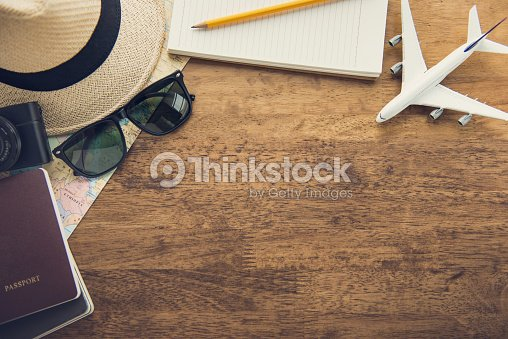 Traveling gadgets on wood table background, top view border design with copy space : Foto de stock