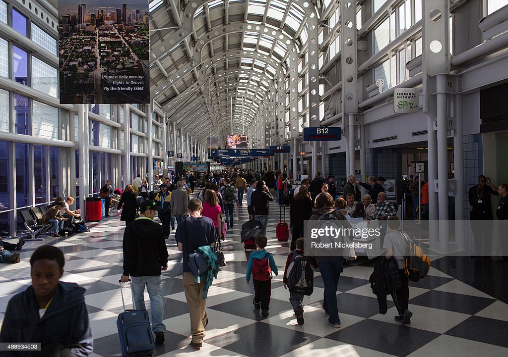 Traveling passengers walk to their flights April 18, 2014 at Chicago's O'Hare International Airport in Chicago, Illinois.
