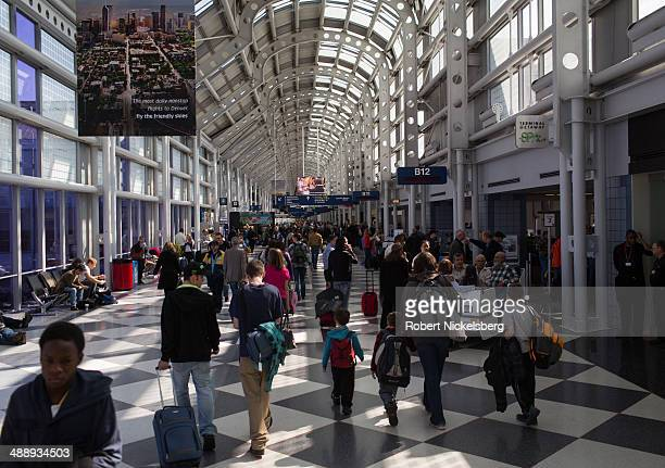Traveling passengers walk to their flights April 18 2014 at Chicago's O'Hare International Airport in Chicago Illinois