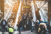 Berlin, Germany - april, 27: Traveling people on crowded escalator inside main train station (Hauptbahnhof) in Berlin.