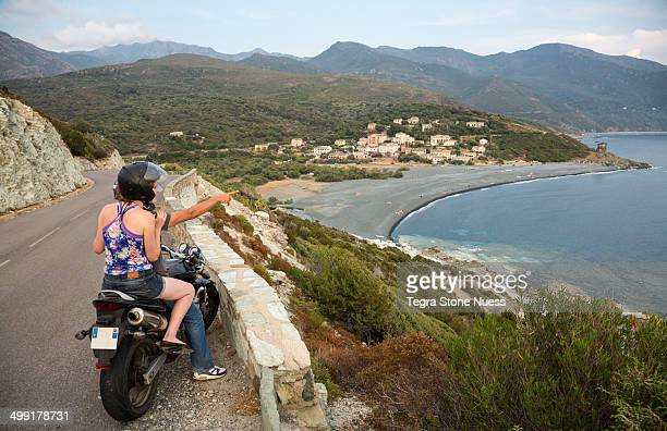 Traveling the Corsican coastline by motorcycle.