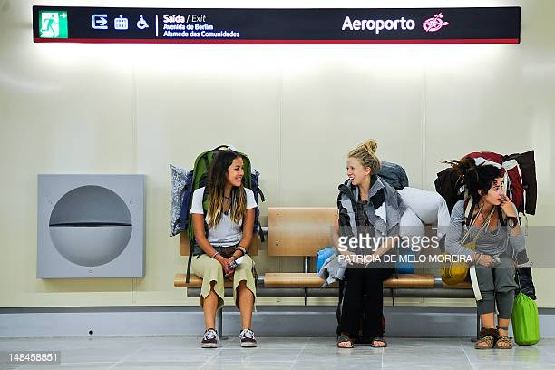 Traveling tourists wait for the subway at the Lisbon airport subway station on July 17 2012 Metro Lisbon inaugurated on July 16 three new subway...