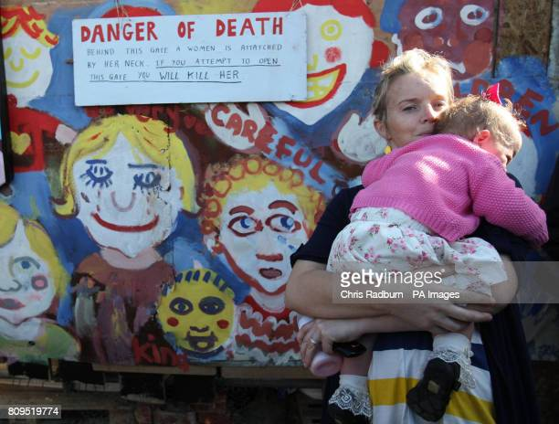 Traveller and resident MaryAnne Sheriden with daughter Katlin stand at the front gate at the Dale Farm travellers site at Cray's Hill near Basildon...