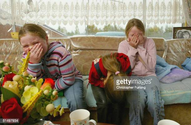 Traveller children Jane Rosella and Natalie enjoy the school holidays in their caravan Dumbarton Scotland on October 19 2004 The Commission of Racial...
