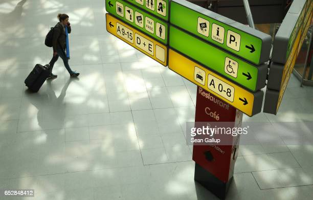 A traveller pulls a suitcase in the main terminal during a strike by ground personnel at Tegel Airport on March 13 2017 in Berlin Germany The strike...