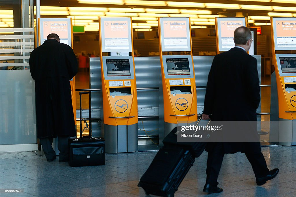 A traveller uses an electronic ticket machine, operated by Deutsche Lufthansa AG, at Frankfurt airport in Frankfurt, Germany, on Thursday, March 14, 2013. Deutsche Lufthansa AG agreed to renew its short-haul fleet with 100 mostly fuel-efficient jets from Airbus SAS, as the airline seeks to cut kerosene costs that constitute its single biggest expense. Photographer: Ralph Orlowski/Bloomberg via Getty Images