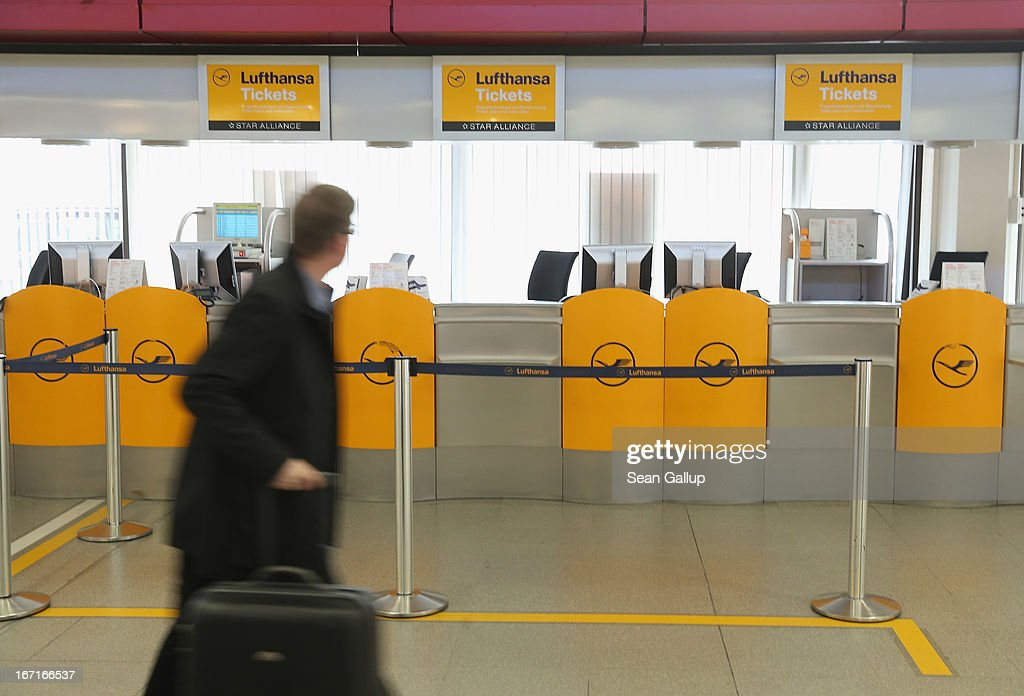 A traveller walks past a closed Lufthansa ticket counter at Tegel Airport during a nationwide strike by Lufthansa ground, service and maintenance personnel on April 22, 2013 in Berlin, Germany. Workers are demanding pay raises and job guarantees and today's strike has forced Lufthansa to cancel approximately 1700 flights.