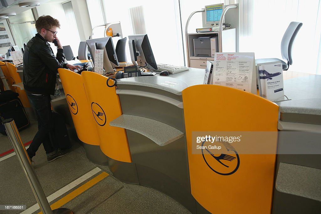 A traveller who had planned to fly to Romania on a Lufthansa flight speaks on a courtesy phone at an empty Lufthansa ticket counter after his flight was cancelled at Tegel Airport during a nationwide strike by Lufthansa ground, service and maintenance personnel on April 22, 2013 in Berlin, Germany. Workers are demanding pay raises and job guarantees and today's strike has forced Lufthansa to cancel approximately 1700 flights.