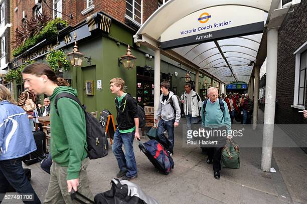 Travellers affected by the air travel ban arrive at Victoria coach station in London UK after travelling from France to Dover Many citizens were...