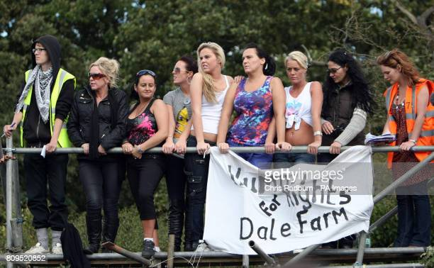 Travellers and other protestors protest from a platform from the front gate at Dale Farm travellers' site at Cray's Hill near Basildon Essex where...