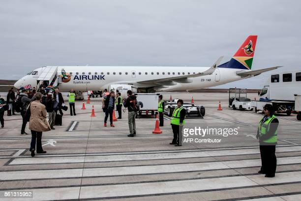 Travellers and passengers get off the first inaugural commercial plane from Johannesburg after landing at the newly built Saint Helena Airport in the...