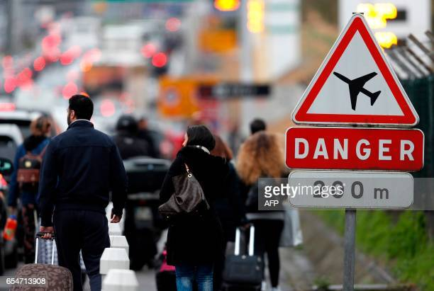 Travellers are evacuated from Paris' Orly airport on March 18 2017 following the shooting of a man by French security forces Security forces at...