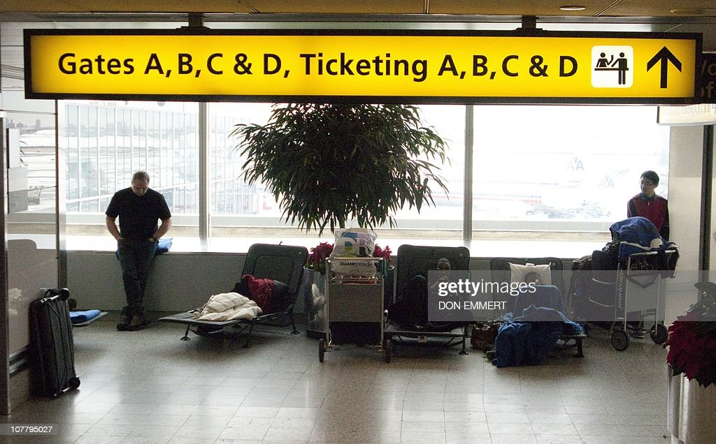 Travellers at LaGuardia airport wait for their flights on cots they had spent the night on December 28 2010 New York Major airports across the US...