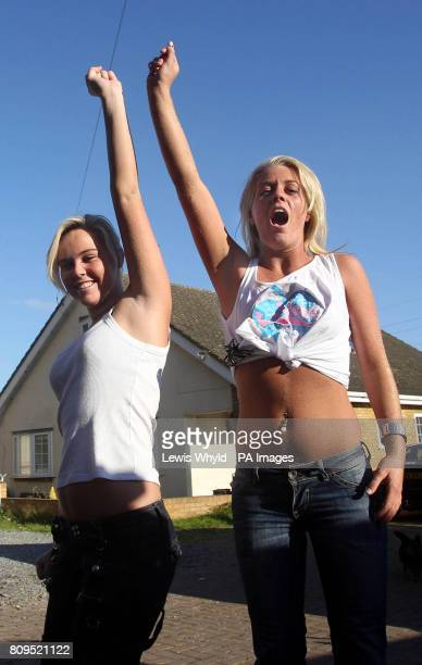 Travellers celebrate after hearing that a Court Order will extend their stay at Dale Farm Travellers Camp until Friday