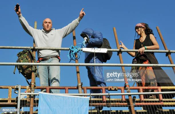 Travellers celebrate after hearing that a Court Order will extend their stay at Dale Farm Travellers Camp in Essex until Friday