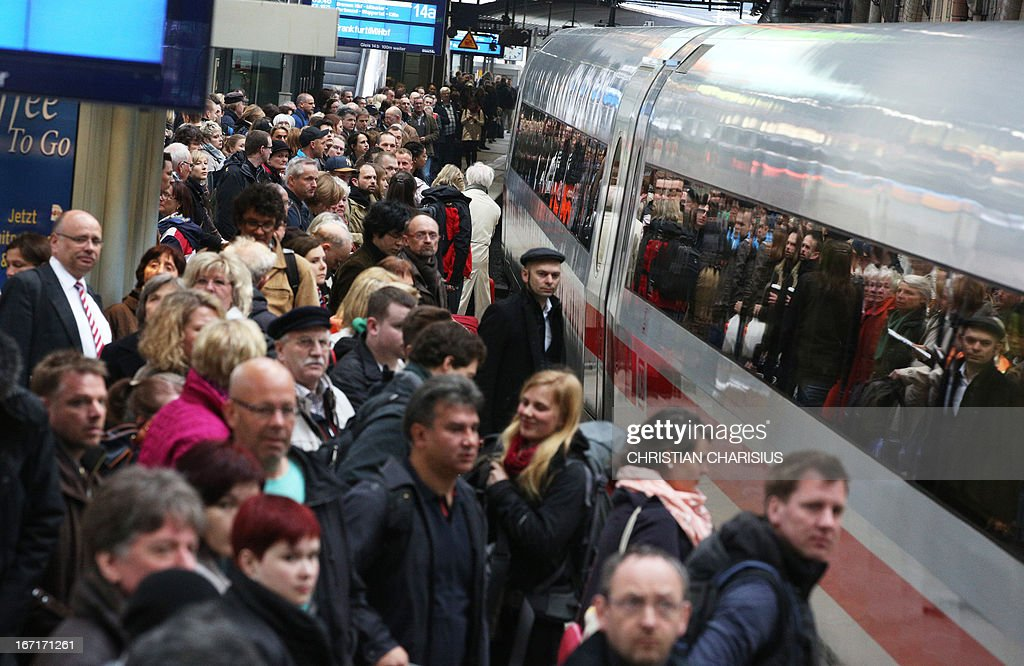 Travellers crowd at the train station in Hamburg, northern Germany, on April 22, 2013, during a warning strike of ground staff of German airline Lufthansa