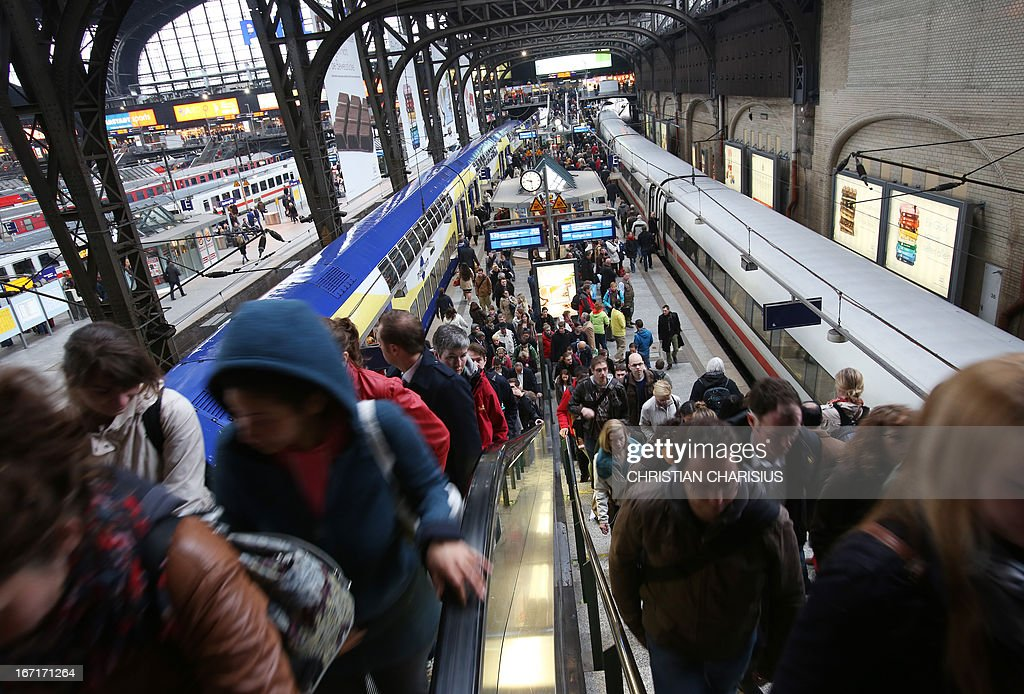 Travellers crowd at the train station in Hamburg, northern Germany, on April 22, 2013, during a warning strike of ground staff of German airline Lufthansa. German airline Lufthansa said it has cancelled most of its domestic, European and long-haul flights at six German airports due to strike action by ground personnel and some cabin crew.