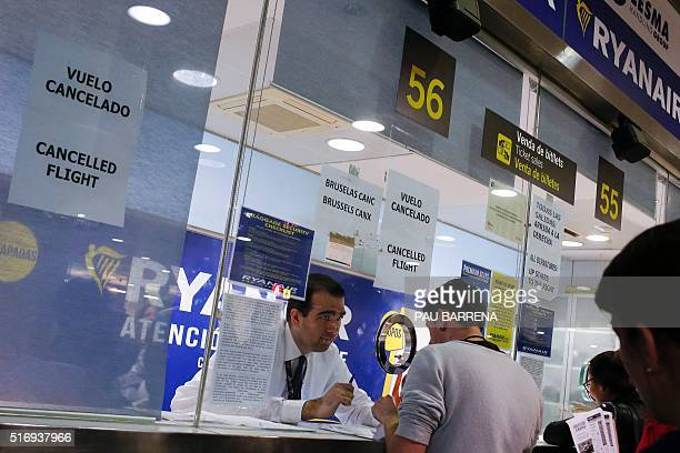 Travellers get informed at Ryanair helping desk at Barcelona El Prat airport after the Brussels attacks in Barcelona on March 22 2016 Europe froze...