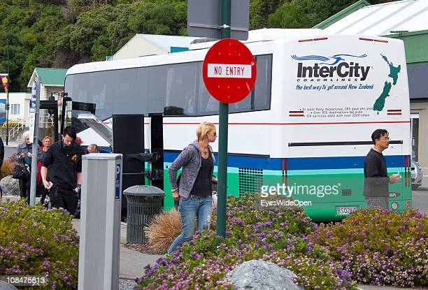 Travellers get off a Intercity bus in the village on December 09 2010 in Kaikoura South Island New Zealand Kaikoura is famous for its whale watching...