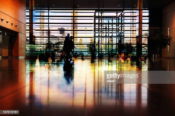 Travellers in silhouette, airport terminal