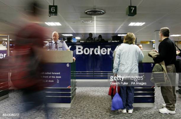 Travellers move through passport control during the official launch of the UK Border Agency at Gatwick Airport in West Sussex